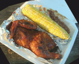 Barbecued chicken and corn on the cob
