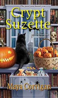 Cover of Crypt Suzette by Maya Corrigan with a black cat, jack o'lantern, candy corn, and shelves with books and Halloween decorations