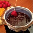 Strawberry being dipping into chocolate fondue